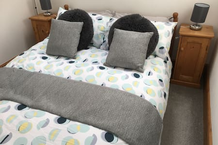 The inside of the Cottage is on one level with a double bed with a 40cm and 50cm gap down the side of the bed.
