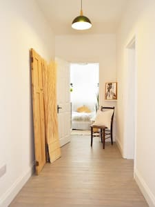 Entrance to main bedroom on right of picture flush to hall floor.