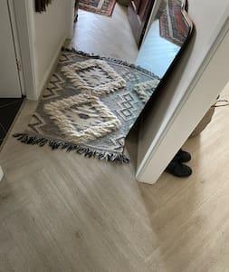Lounge room to bedroom hallway