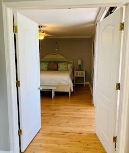 double doors into master bedroom, direct lanai access.