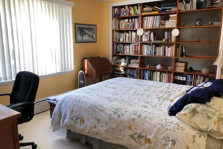 The bedroom is on the same level as the rest of the space. The door width is 28 inches. The bed is directly inside, next to the door.