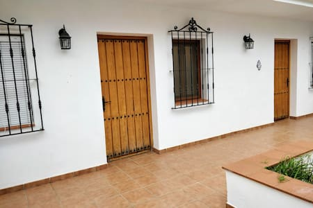 There are no stairs or steps to get into the room, and there's a flat path through the entryway. All the downstairs accommodation is level, no steps, thresholds or ramps.