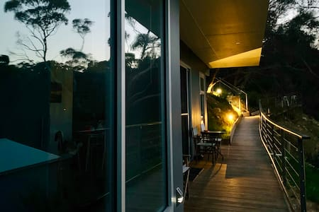 If guests arrive at night there is a well lit ramp from top car park to entrance by wide sliding door into apartment.  Master bedroom is front left.