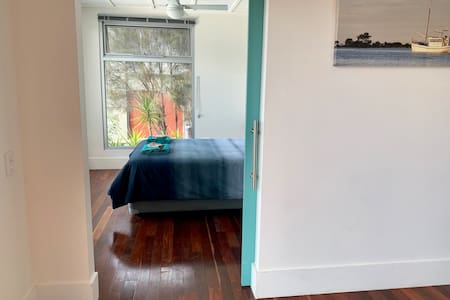 Both bedrooms have wide access by sliding door from hallway and community area.