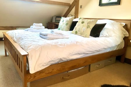 King Size oak bed frame with memory gel mattress. Feather and foam pillows available.