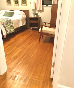 Flat, wide entry to Bedroom 1
