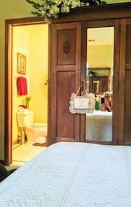 The master bath is right off the master bedroom and also has access to the kitchen hallway at 1 level.