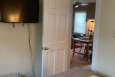 Queen bedroom entry into kitchen and living room and bathroom access