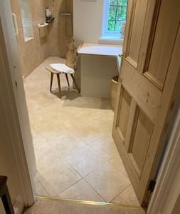 Entrance from downstairs double bedroom to bathroom ( walk in shower) toilet basin