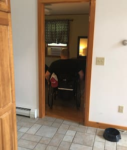 First Floor bathroom - doors wide enough for wheelchair w/ bed at transfer level from manual chair