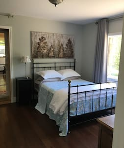 This bedroom is on the main floor with a large en-suite and this room is off the main living area