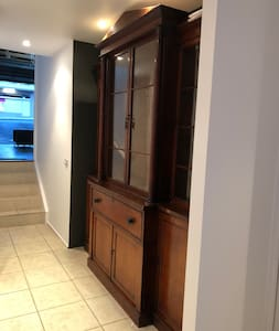 Just before the stairs to garage, the door to the master bedroom is on the left all on 1 level.