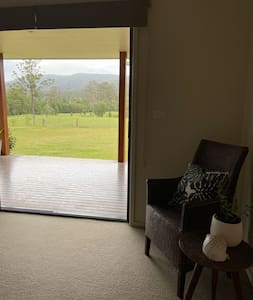 3 glass sliding doors with direct access to front deck.