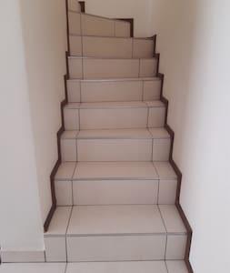 Stairway leading to bedroom with en suite and patio/balcony area from Living room