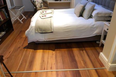 Wide doorway to bedroom, small (1cm) lip on floor (sliding loovered doors track)