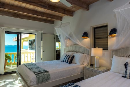 The Caribe #1 double queen bedroom suite is located on the same level as the Great Room.