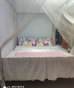 A double bed with mosquito net