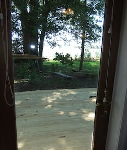 """Double-Door French hurricane door (opens outward) provides a six foot entrance.   Interior door jamb is 32""""."""