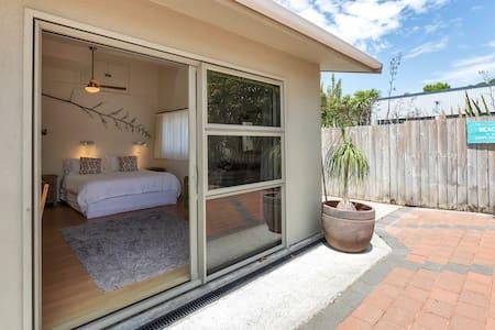 Access to Bush Room bedroom through ranch slider or internal door