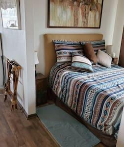 unobstructed space between bedroom and living room area