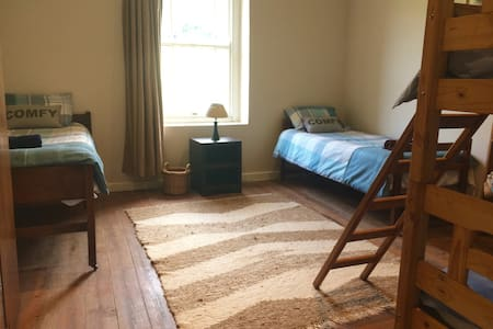All rooms on same level. Level wooden floors in all the bedroom and lounge