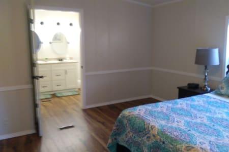 entry door to bathroom from master bedroom (bedroom #1)