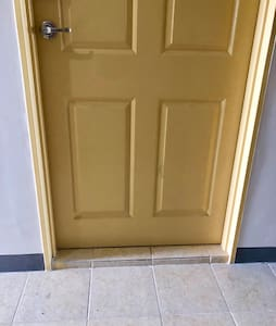 Main door with a step of 1-inch height.