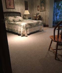 No steps into large bedroom.  There is an outside door in this bedroom also.