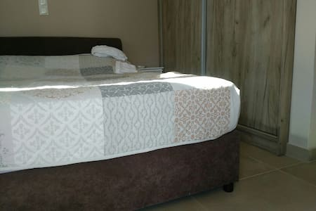 The beds are both 21.5 inches high, from the floor to the top of the mattress. 160cm and 90cm wide, 2m length,  larger than average double and larger than average single. Very comfortable.