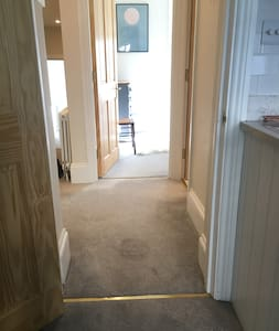 Shows access from living room and kitchen to Bedroom 2. Bathroom access is also step free on right