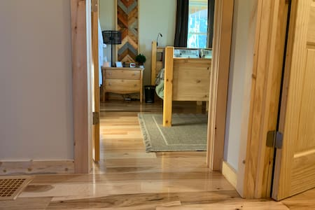 """This is the entrance to the main bedroom on the main floor. There are no steps to enter this room, and doors are 32"""" wide."""