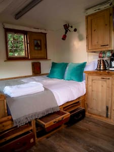 There is no doorway to the bedroom area, the hut is open plan
