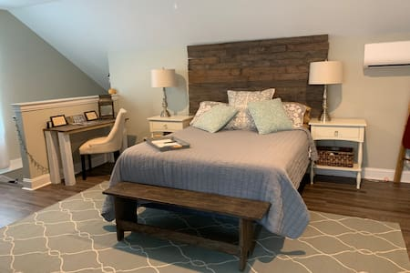 There is plenty of space around this queen size bed. Over 4 feet of space on each side of the bed.