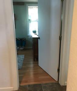 """1 bedroom has a wide door. 36"""""""