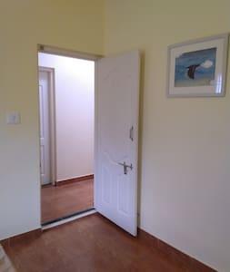 The 100cm wide x 210cm high door to the bedrooms