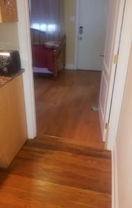 Cross a half inch lip to enter this 1st floor bedroom from the 1st floor great room.