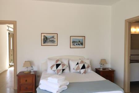 Bedroom 1 on same floor as villa entrance Walk in shower , large door entrance to en-suite