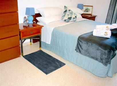 The bedroom is accessed via a wide hallway from the entrance. There is a wide area next to the bed, which opens onto the en suite toilet. The bed is 57cm high.