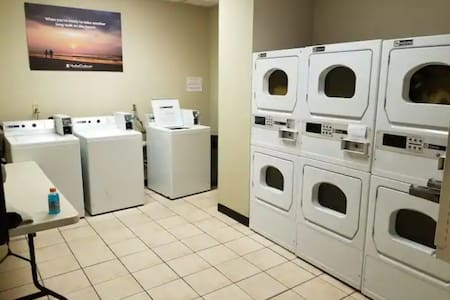 Laundry room located on the first floor across from elevator #1 and the main entrance to the lobby.