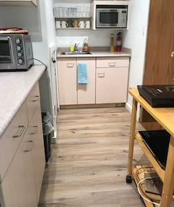 The floor in the kitchen area is flat and level.