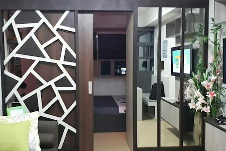 its 1 bedroom with sliding door and open divider