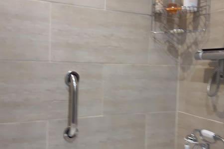 Barras de apoio fixas para o chuveiro