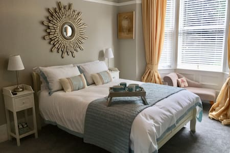 There is no step between the hallway and master bedroom and there is space around the bed for easier access.  The top of the mattress is quite high from the floor as it is a deep pocket sprung mattress with extra comfort topper.