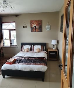 Beautiful big spacious room with side locker, wardrobe and chest drawers and two big windows.