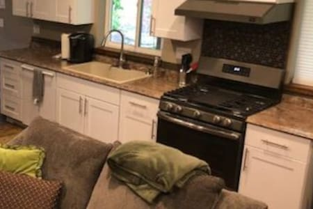 Full Kitchen with Range/oven, microwave, sink and dishwasher.