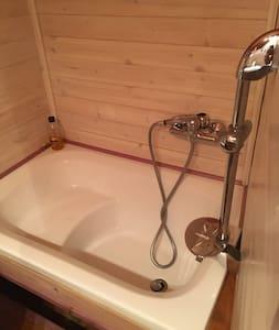 Bathtub with bath chair