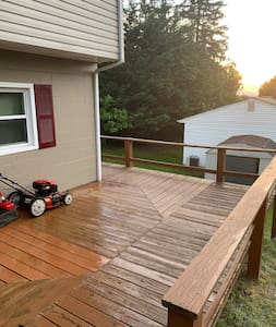 Wrap around deck that leads to the Airbnb private entrance. No stairs.