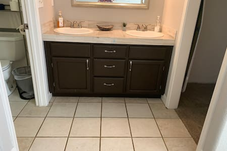 Extra wide entrance to master bathroom sink area
