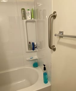 Grab bar to assist entry into the shower in upstairs full bath.
