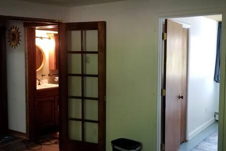bedroom door is on the right (blue carpet in room)